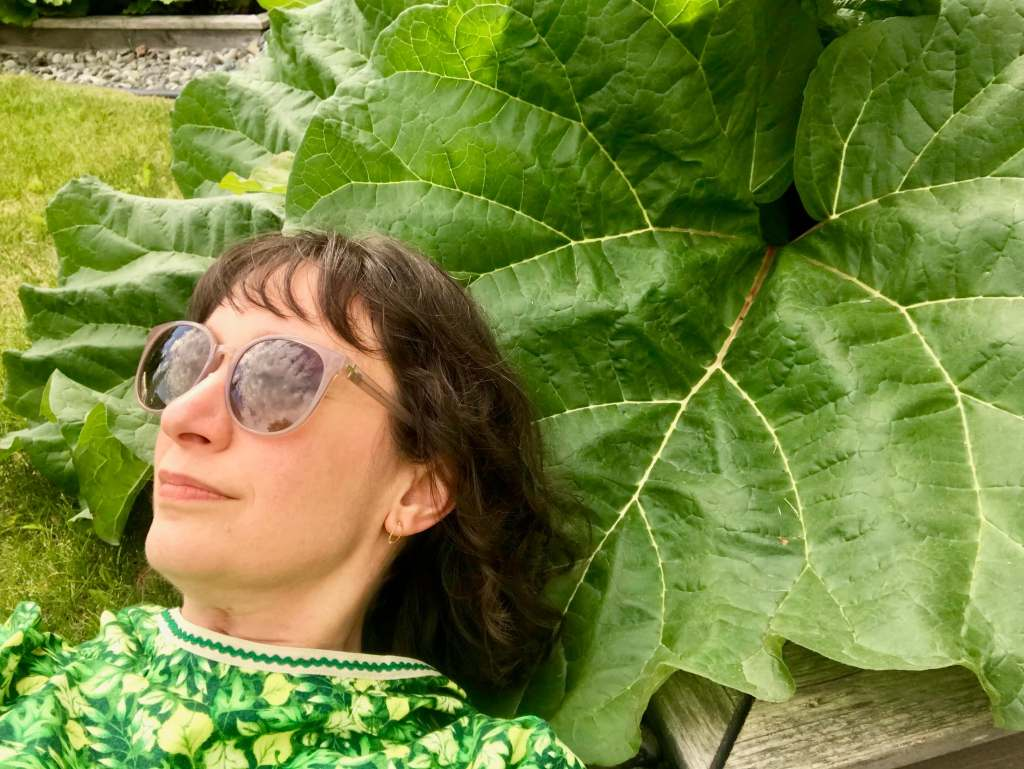 Selfie with rhubarb leaf